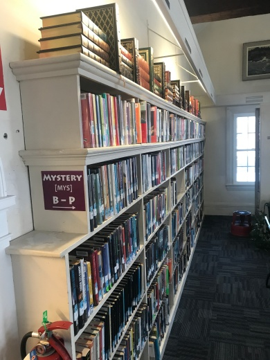 Book cases lining the wall at the Boothbay Harbor Memorial Library.
