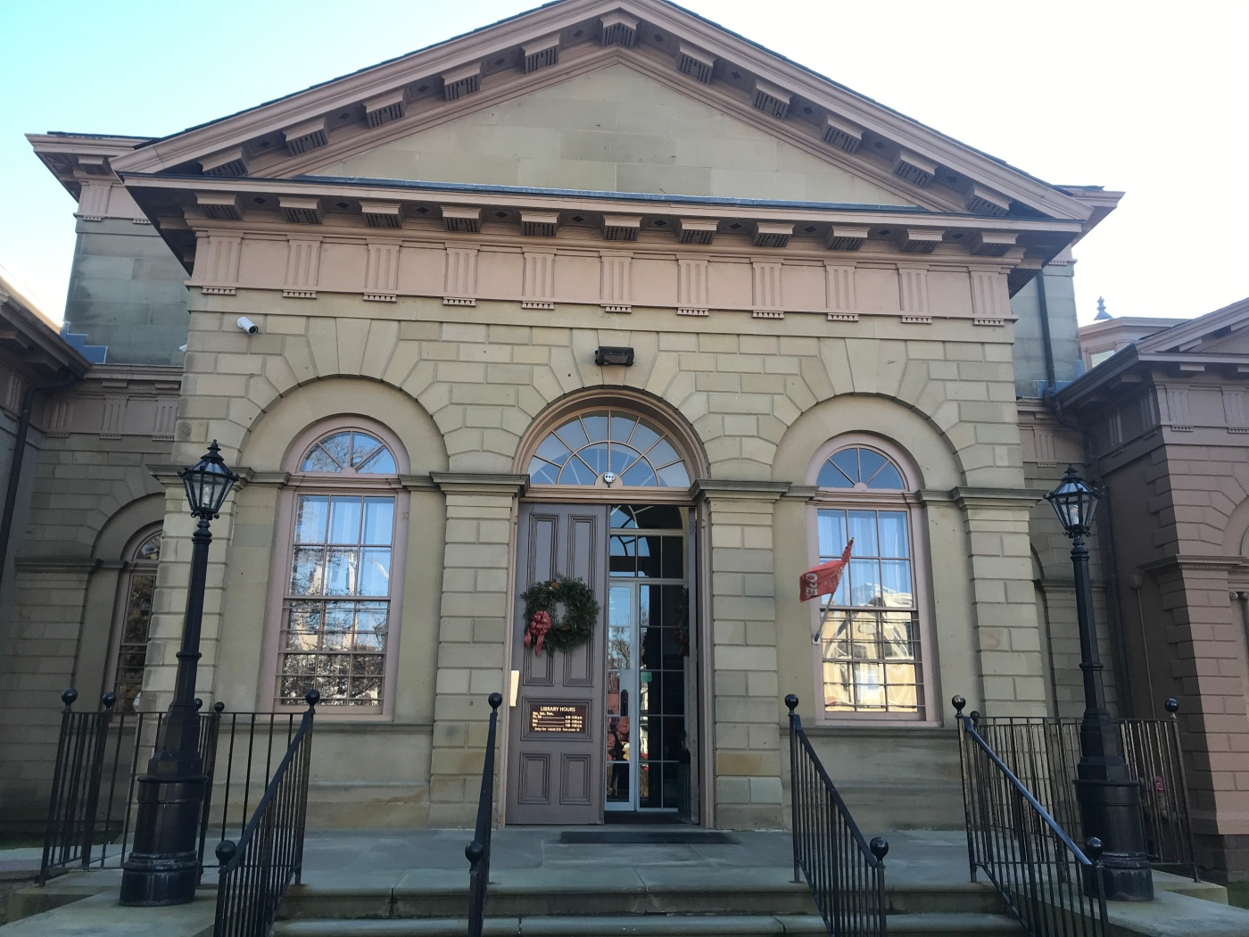 The neoclassical exterior of the Redwood Library and Athenaeum in Newport, RI.